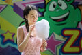 Cute Caucasian Girl In Amusement Park Is Eating Pink Candyfloss. Portrait Of Happy Attractive Young Woman With Cotton Candy. Royalty Free Stock Photos - 88885658