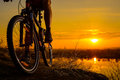 Silhouette Of Enduro Cyclist Riding The Mountain Bike On The Rocky Trail At Sunset. Active Lifestyle Concept. Space For Text. Royalty Free Stock Image - 88898886
