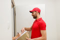 Delivery Man With Box And Customer Signing Form Stock Photos - 88912133