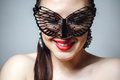 Beautiful Woman With Black Lace Mask Over Her Eyes. Red Sexy Lips And Nails Closeup. Stock Image - 88916391