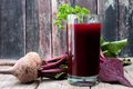 Beet Juice Against A Rustic Wooden Background Stock Photography - 88919252