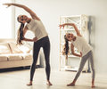 Mom And Daughter Doing Yoga Stock Photos - 88937043