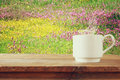 Cup Of Coffee A Wooden Table In Front Of Spring Landscape Royalty Free Stock Images - 88938149