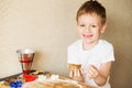 Children`s Hands Make Gingerbread. Small Boy Cutting Cookies For Stock Photo - 88969860