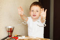 Children`s Hands Make Gingerbread. Small Boy Cutting Cookies For Royalty Free Stock Images - 88969889