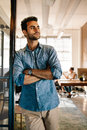 Young Man Standing At Door While Colleagues In Background Royalty Free Stock Photos - 88996908