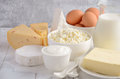 Fresh Dairy Products. Milk, Cheese, Brie, Camembert, Butter, Yogurt, Cottage Cheese And Eggs On Wooden Table. Royalty Free Stock Photography - 89006347