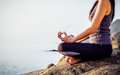 The Woman Meditating In A Yoga Pose On The Tropical Beach. Femal Royalty Free Stock Images - 89065369