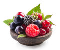 Berries In Wooden Plate Isolated On White Stock Image - 89073061