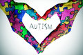 Text Autism And Hands Forming A Heart With Puzzle Pieces Royalty Free Stock Image - 89087546