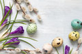 Easter Eggs And Floral Abstract On Wooden Background Stock Photos - 89115333
