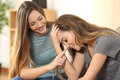 Girl Trying To Comfort To Her Sad Friend Stock Image - 89124801