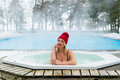 Young Blonde Woman In Red Hut In Bathtub Jacuzzi Outdoors At Winter Stock Image - 89143991