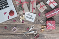 Christmas Gift Boxes And Cropped Computer On Vintage Wood Background Stock Images - 89145364