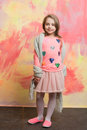 Small Happy Baby Girl In Pink Skirt, Scarf And Shirt Stock Photos - 89145513
