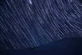 Star Trails Over Mountains In Winter Time Royalty Free Stock Photography - 89163247