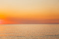 Calm Sea Or Ocean And Yellow Clear Sunset Or Sunrise Sky Background Royalty Free Stock Photo - 89165665