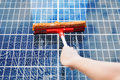 Person Cleaning Solar Panel Royalty Free Stock Photos - 89187848