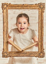 Expressive Young Little Girl Reading A Book Stock Image - 89222621