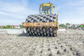 Huge Road Roller With Spikes Is Compacting Soil At Construction Stock Photography - 89253382