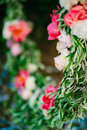 Round Wedding Arch Of Flowers And Olive Branches. Hanging On The Stock Image - 89264591