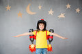 Kid Playing With Jet Pack At Home Royalty Free Stock Photo - 89271505