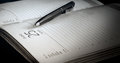 The Ball-point Pen Lies On The Open Page Of The Daily Log. Royalty Free Stock Images - 89289219