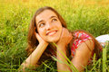 Young Beautiful Girl Lays On A Grass Stock Photos - 89301753