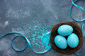 Three Blue Speckled Eggs In Bird Nest , Easter Holiday Decoratio Stock Images - 89318934