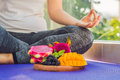 Hand Of A Woman Meditating In A Yoga Pose, Sitting In Lotus With Fruits In Front Of Her Dragon Fruit, Mango And Mulberry Stock Photography - 89329262
