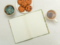 Open Note Book With Tea,cookies,plant.white Wooden Table. Stock Photo - 89364960
