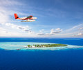 Seaplane Flying Above Small Tropical Island On Maldives Stock Photo - 89385470