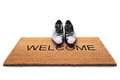 Shoes On A Doormat With The Word Welcome Stock Photo - 89458710