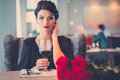 Elegant Lady With Red Roses In Restaurant Royalty Free Stock Photography - 89472087