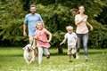 Happy Children And Parents With Dog Stock Image - 89478561
