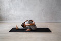 Woman Practicing Advanced Yoga. A Series Of Yoga Poses Royalty Free Stock Image - 89493676