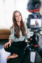 Beautiful Girl Recording Video On Tripod Camera In Her Living Ro Stock Photos - 89515923