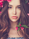 Beautiful Young Woman Surrounded By Flowers Stock Photos - 89529213