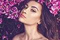 Beautiful Young Woman Surrounded By Flowers Royalty Free Stock Photo - 89529235