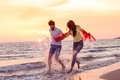Happy Young Romantic Couple In Love Have Fun On Beautiful Beach At Beautiful Summer Day Stock Photos - 89552663