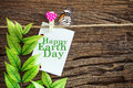 Happy Earth Day Paper Note Hanging By Red Heart Clips On Wooden Stock Photo - 89569290