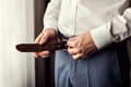 Businessman Putting On A Belt. Man Puts On Brown Belt. Focus On Stock Photos - 89573033