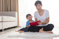 Asian Chinese Mother And Daughter Reading On The Floor Royalty Free Stock Images - 89592029