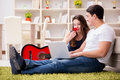 The Romantic Pair Playing Guitar On Floor Stock Images - 89618224