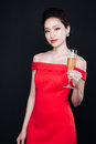 Young Asian Woman In Luxury Red Dress With Glass Of Sparkling Wi Stock Image - 89639641