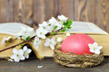Easter Card With Easter Egg  In The Nest, Spring Flowers And Old Book Royalty Free Stock Photography - 89653537