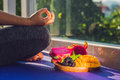 Hand Of A Woman Meditating In A Yoga Pose, Sitting In Lotus With Fruits In Front Of Her Dragon Fruit, Mango And Mulberry Royalty Free Stock Image - 89656966