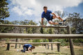 Man And Woman Jumping Over The Hurdles During Obstacle Course Royalty Free Stock Photo - 89667145