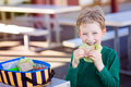 Kid Eating School Lunch Royalty Free Stock Photos - 89673868
