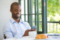 Businessman Holding Mobile Phone In Restaurant Stock Photos - 89676313